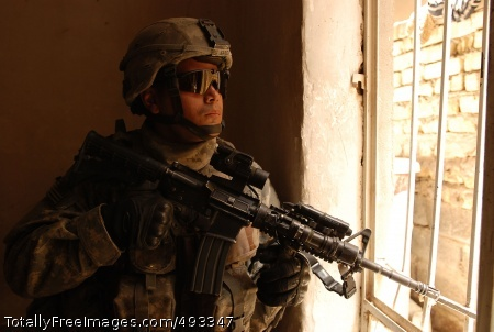 Paratroopers Take Spc. Antonio Garcia, a paratrooper with Company C, 2nd Battalion, 325th Airborne Infantry Regiment, 2nd Brigade Combat Team, 82nd Airborne Division, pulls security while his platoon leader talks to the owner of a house during a cordon and search operation in east Baghdad's Sha'ab neighborhood May 10. 