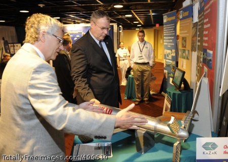 110606-N-PO203-031 ARLINGTON, Va. (June 6, 2011) Dr. Jerome Fanucci, chief executive officer of Kazak Composites, Inc., explains his company's products to Undersecretary of the Navy Robert O. Work during the 2011 Navy Opportunity Forum sponsored by the Navy Small Business Innovation Research Program Office. (U.S. Navy photo by John F. Williams/Released)