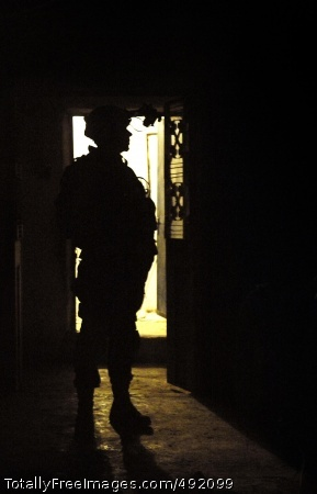 Title A Soldier enters a room during a night air assault. Photo Credit: Aug 14, 2007