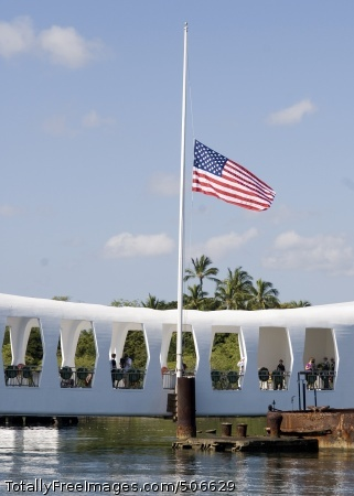 101207-N-5476H-300 PEARL HARBOR (Dec. 7, 2010) The national ensign flies at half-mast during a ceremony commemorating the 69th anniversary of the Dec. 7, 1941 Japanese attack on Pearl Harbor. The National Park Service and the U.S. Navy hosted a memorial ceremony to dedicate the new $56 million Pearl Harbor Visitor Center at the World War II Valor in the Pacific National Monument, formerly known as the USS Arizona Memorial Visitor Center. (U.S. Navy photo by Mass Communication Specialist 2nd Class Michael Hight/Released)