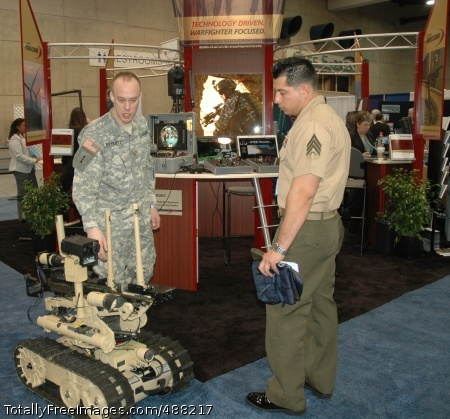 SWORDS 1st Photo Maj. Michael Pottratz, U.S. Armament Research, Development and Engineering Center's explosive ordnance disposal deputy director of technology, explains the functions of the SWORDS robot at the WEST 2008 conference.  Photo Credit: Feb 7, 2008