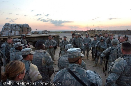 The Huddle Soldiers from the 25th Infantry Division get a  mission brief before delivering a convoy of food and water to residents of Tal Afar, Iraq. Photo Credit: Apr 26, 2007