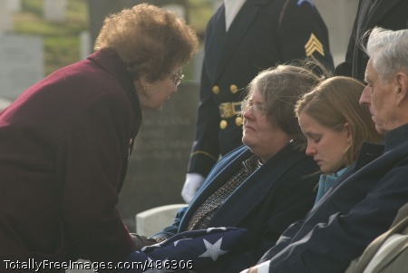 The Ladies of After the folded flag is presented to the fallen Soldier's family, the Arlington Lady steps forward to offer words of condolence. Photo Credit: May 5, 2008