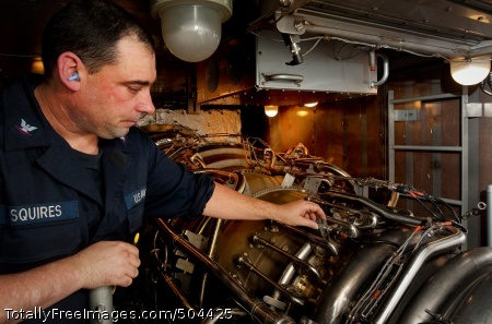 110204-N-9589S-195 ATLANTIC OCEAN (Feb. 4, 2011) Gas Turbine System Technician (Electrical) 3rd Class Christopher A. Squires verifies a repair on a gas turbine engine aboard the Arleigh Burke-class guided-missile destroyer USS Truxtun (DDG 103). Truxtun is conducting a composite training unit exercise as part of the George H.W. Bush Carrier Strike Group to prepare for an upcoming deployment. (U.S. Navy photo by Mass Communication Specialist 3rd Class Richard J. Stevens/Released)