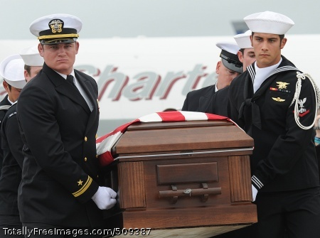 100927-N-4420S-206 JOINT BASE MCGUIRE-DIX-LAKEHURST, N.J. (Sept. 27, 2010) Navy SEALs carry the casket of Special Warfare Operator (SEAL) 3rd Class Denis Miranda off the flight line of Joint Base McGuire-Dix-Lakehurst. Miranda was one of nine service members killed when the helicopter in which they were traveling crashed in Zabul Province in Southern Afghanistan Sept. 21. (U.S. Navy photo by Mass Communication Specialist 2nd Class John Scorza/Released)