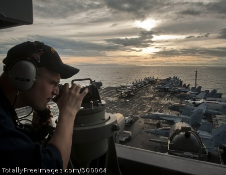 110528-N-DR144-298 SURIGAO STRAIT (May 28, 2011) Quartermaster Seaman Jacob Williams uses a telescopic alidade to establish the bearing of known reference points on islands in the Philippines as the Nimitz-class aircraft carrier USS Carl Vinson (CVN 70) and ships assigned to Carrier Strike Group (CSG) 1 approach the Surigao Strait.  Carl Vinson and Carrier Air Wing (CVW) 17 are underway in the U.S. 7th Fleet area of responsibility. (U.S. Navy photo by Mass Communication Specialist 2nd Class James R. Evans/Released)