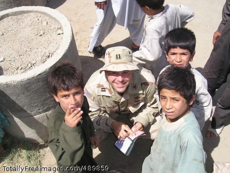 Army Major Goes Maj. (then-Capt.) Todd Schmidt poses with Afghan boys during a school-supply distribution event. The grassroots effort quickly became Operation Dreamseed, which has distributed hundreds of tons of school supplies to children in Afghanistan, Iraq and Kosovo and helped build a school outside of Kandahar City by raising over $80,000. Maj. Schmidt received the Microsoft Above and Beyond Everyday Difference Award for his efforts.  Photo Credit: Nov 13, 2007