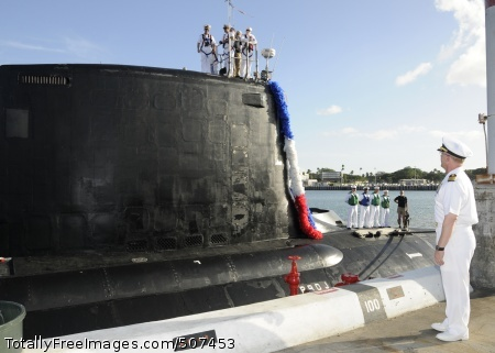 101115-N-3560G-004 PEARL HARBOR (Nov. 15, 2010) Capt. Daryl Caudle, commander of Submarine Squadron 3, welcomes the Virginia-class attack submarine USS North Carolina (SSN 777) as she arrives at Joint Base Pearl Harbor-Hickam after completing a four-month inter fleet transfer from her former homeport at Groton, Conn. North Carolina is the third Virginia-class submarine to be stationed in the Pacific region. (U.S. Navy photo by Mass Communication Specialist 2nd Class Ronald Gutridge/Released)