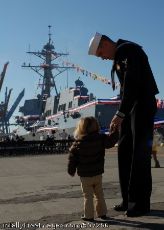 101120-N-3737T-014  WILMINGTON, N.C. (Nov. 20, 2010) Hours before the official ceremony, Gunner's Mate 3rd Class Zachary Fleming walks with his daughter near the ship. The U.S. Navy commissioned its newest guided missile destroyer, USS Gravely (DDG 107). The new destroyer honors the late Vice Adm. Samuel L. Gravely Jr., who was the first African American to command a warship, USS Theodore E. Chandler (DD 717); to command a major warship, USS Jouett (DLG/CG-29); to achieve flag rank and eventually vice admiral; and to command a numbered fleet, the U.S. 3rd Fleet. (U.S. Navy photo by Mass Communication Specialist 2nd Class Eric Tretter/Released)