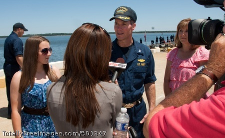 110429-N-FG395-091 KINGS BAY, Ga. (April 29, 2011) Capt. Thomas Calabrese, commanding officer of the Gold crew of the Ohio-class guided-missile submarine USS Florida (SSGN 728), is interviewed by local media on the pier during a homecoming celebration for the Ohio-class guided-missile submarine USS Florida (SSGN 728) at Naval Submarine Base Kings Bay. Florida returned after a 15-month deployment. Florida participated in Operation Odyssey Dawn, becoming the first guided-missile submarine to launch Tomahawk land attack missiles. (U.S. Navy photo by Mass Communication Specialist 1st Class James Kimber/Released)