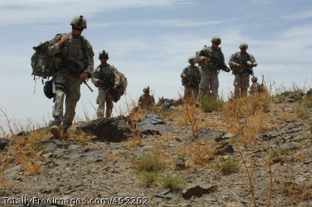 Afghanistan by Foot Soldiers keep their footings as they walk on the uneven surface.  Photo Credit: Aug 6, 2007
