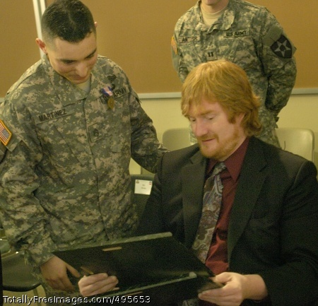NCO receives Staff Sgt. Moises Martinez talks with Dan McKowan whose life Martinez was credited with saving after McKowan was shot five times during a mall shooting. Martinez received the Soldier's Medal for his actions.  Photo Credit: Dec 26, 2006