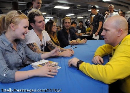 101105-N-7095C-345 ARABIAN GULF (Nov. 5, 2010) Cheyenne Kimball, of the country music band Gloriana, talks with Aviation Boatswain's Mate (Handling) 1st Class Todd A. Rogers during an autograph session for Sailors aboard the aircraft carrier USS Abraham Lincoln (CVN 72). The band later performed a concert for Sailors as part of a program sponsored by the Abraham Lincoln morale, welfare and recreation program. The Abraham Lincoln Carrier Strike Group is deployed to the U.S. 5th Fleet area of responsibility supporting maritime security operations and theater security cooperation efforts. (U.S. Navy photo by Mass Communication Specialist 2nd Class Seth Clarke/Released)