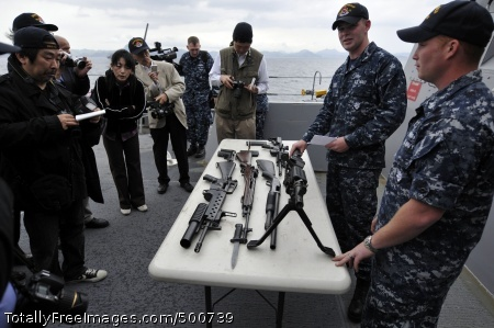 110517-N-WW409-196 YOKOSUKA, Japan (May 17, 2011) Gunner's Mate 1st Class Michael Hoar, right, and Gunner's Mate 3rd Class Kaleb Casey Williams show members of the Japanese media the small arms weapons used aboard the guided-missile destroyer USS Fitzgerald (DDG 62) during a daylight embark. Members of the media and local city and government officials are touring the ship, observing demonstrations of man overboard and crash and salvage drills. (U.S. Navy photo by Mass Communication Specialist 1st Class Jennifer A. Villalovos/Released)
