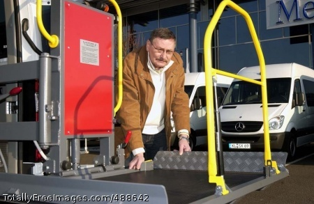 WTU Vans Ready to Gerhard Heil, U.S. Army Garrison Kaiserslautern transportation motor pool manager, tests a wheelchair ramp installed on one of the 14 vans meant for Warrior Transition Units in Europe. Photo Credit: Jan 9, 2008