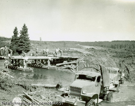 Iron Men and Iron Image shows the construction of a bridge along the ALCAN highway, 1942. (WW2 Signal Corps Collection). Photo Credit: Oct 21, 2007