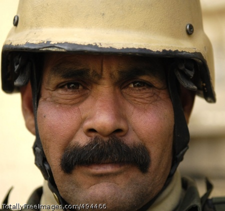 Faces of the Long An Iraqi Soldier from 4th Battalion, 2nd Brigade, 5th Iraqi Army Division patrols Buhriz, Feb. 17.  Photo Credit: Mar 14, 2007