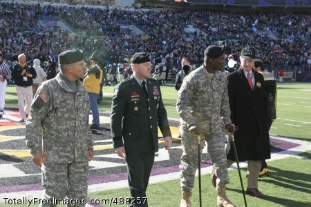 Lt. Col. Gadson at Lt. Col. Greg Gadson (second from right) walks off the field on his two prosthetic legs Dec. 5 after the coin toss for the Army-Navy game.  He is accompanied by Army Chief of Staff Gen. George Casey Jr., Superintendent of West Point Lt. Gen. Buster Hagenbeck, and Secretary of the Army Pete Geren. Photo Credit: Feb 4, 2008