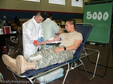 Europe Blood Bank Hospital Corpsman First Class Michael Beam draws blood from 2nd Lt. Alex Borowicz during a community blood drive in Darmstadt, Germany. Borowicz's donation enabled the Armed Services Blood Bank Center-Europe to surpass the 5,000 complete unit mark. Photo Credit: Jan 7, 2008