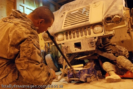 Army Mechanics Go Mechanics from Headquarters Support Company, 864th Engineer Battalion raise a Humvee that needs repair up on jacks while determining how to fix it at Forward Operating Base Sharana, Afghanistan, Nov. 7.' Photo Credit: Nov 27, 2007
