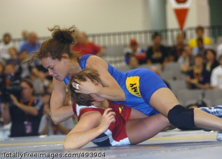 All-Army Female All-Army wrestler First Lt. Leigh Jaynes (top) posts a 5-1, 7-2 victory over Erin Tomeo of Sunkist Kids Wrestling Club in the women's 130-pound freestyle finale of the 2007 U.S. National Wrestling Championships April 6 at Las Vegas Convention Center. First Lt. Jaynes qualified for the U.S. World Team Trials, scheduled for June 9-10 in Las Vegas.    Photo Credit: Apr 19, 2007