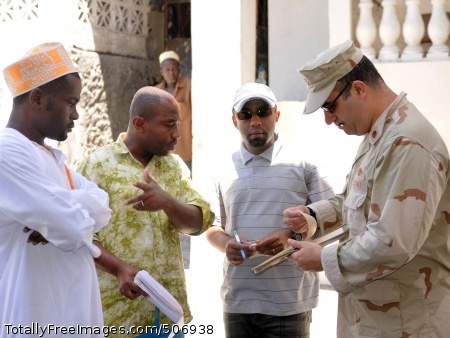 100917-F-9112H-055 MORONI, Union of Comoros (Oct. 9, 2010) A member of Maritime Civil Affairs and Security Training (MCAST) Command speaks with civic leaders during a mission to the Union of Comoros. MCAST Command, homeported at Joint Expeditionary Base Ft. Story-Little Creek, Va., provides maritime civil affairs and security force assistance in support of U.S. Maritime Strategy. (U.S. Navy photo by Lt. Timm Heisey/Released)