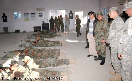 Soldiers work with Army Command Sgt. Maj. William J. Gainey, senior enlisted advisor to the chairman, Joint Chiefs of Staff, watches as Afghan National Army trainees practice rifle marksmanship during his visit to Afghanistan Nov. 22. Photo Credit: Nov 27, 2006