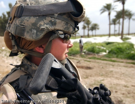 Protecting Her Sgt. Ashley Hort keeps her weapon at the ready as she provides security for her fellow Soldiers during a raid in Al Haswah, Iraq, March 21. Hort is from the 127th Military Police Company. Photo Credit: Mar 30, 2007
