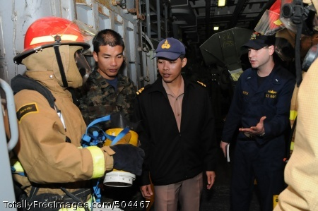 110203-N-6692A-022 PACIFIC OCEAN (Feb. 3, 2011) Lt. j.g. Kevin Krmpotich, right, training officer aboard the amphibious transport dock ship USS Denver (LPD 9), explains the function of a naval firefighting thermal imager to Royal Thai Navy lieutenants Srikrung Jai-in, center, and Lt. Kris Sombunsub during a general quarters drill aboard Denver. Srikrung and Sombunsub are observing U.S. Navy ship operations during Cobra Gold 2011. Cobra Gold is a joint military exercise involving amphibious operations, artillery training, tactical interoperability exercises and community service projects for the U.S. and host country military. (U.S. Navy photo by Mass Communication Specialist 1st Class Geronimo C. Aquino/Released)