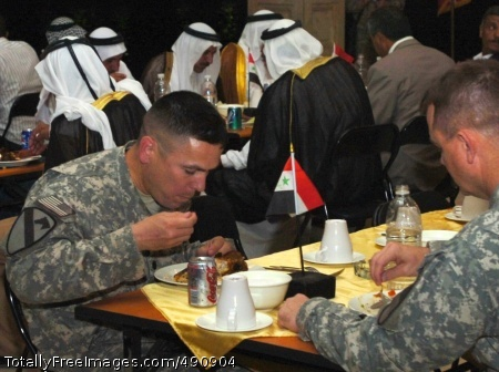 Lt. Col. Kurt Pinkerton, commander, 2nd 'Lancer' Battalion, 5th Cavalry Regiment, and Col. Paul E. Funk II, commander, 1st 'Ironhorse' Brigade Combat Team, 1st Cavalry Division dine in the presence of Abu Ghraib tribal leaders and government officials during a dinner held at Camp Liberty, Iraq Oct. 1 to celebrate the success of recent reconciliation efforts within Abu Ghraib.  Photo Credit: Oct 3, 2007