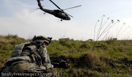 Preparing for A Soldier provides security after dismounting a UH-60 Black Hawk helicopter. Photo Credit: May 9, 2007