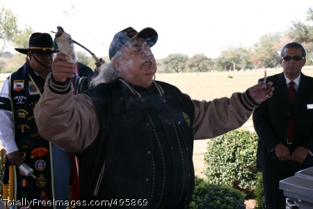 Soldier honored Richard Naateh Luna, a Korean War veteran from the White Mountain Apache tribe, prays in an ancient Native American language so Martiriano Aguirre's spirit can be released to his creator. The burning sage is for cleansing.