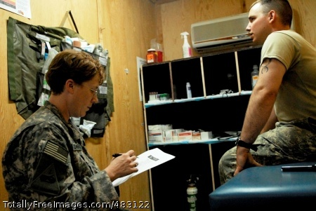 Neurologist Brings Lt. Col. (Dr.) Margaret Swanberg, of Montgomery Village, Md., asks Spc. Michael Woywood, of San Antonio, questions during a military acute concussion evaluation demonstration at Forward Operating Base Hammer, Iraq, July 18, 2008.  Photo Credit: Jul 25, 2008