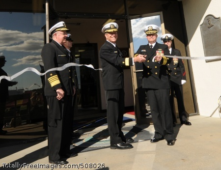 101029-N-5085J-155 NORFOLK (Oct. 29, 2010) Adm. John C. Harvey, commander of U.S. Fleet Forces Command, looks on as Rear Adm. Jonathan W. White, commander of Naval Meteorology and Oceanography Command, and Capt. William H. Nisley II, commanding officer of Fleet Weather Center Norfolk, Va., cut the ribbon during the Fleet Weather Center Norfolk, Va. establishment ceremony at Naval Station Norfolk. The Fleet Weather Center Norfolk, Va. will assume the duties and responsibilities of Naval Maritime Forecast Center Nofolk, Naval Aviation Forecast Center and Strike Group Oceanography Team, which were disestablished during a ceremony Oct. 28. (U.S. Navy photo by Mass Communication Specialist 3rd Class William Jamieson/Released)