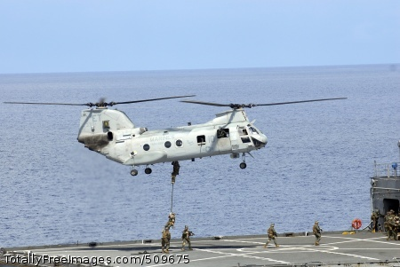 100918-N-8335D-500 PHILIPPINE SEA (Sept. 18, 2010) Marines assigned to the 31st Marine Expeditionary Unit (31st MEU) embarked aboard the amphibious assault ship USS Essex (LHD 2) fast rope from a CH-46 Sea Knight helicopter onto the Military Sealift Command dry cargo and ammunition ship USNS Alan Shepard (T-AKE 3) during a visit, board, search and seizure exercise. Essex is on patrol in the western Pacific Ocean and is part of the permanently forward-deployed Essex Amphibious Ready Group participating in Valiant Shield 2010, an integrated joint-training exercise designed to enhance interoperability between U.S. forces. (U.S. Navy photo by Mass Communication Specialist 1st Class Richard Doolin/Released)