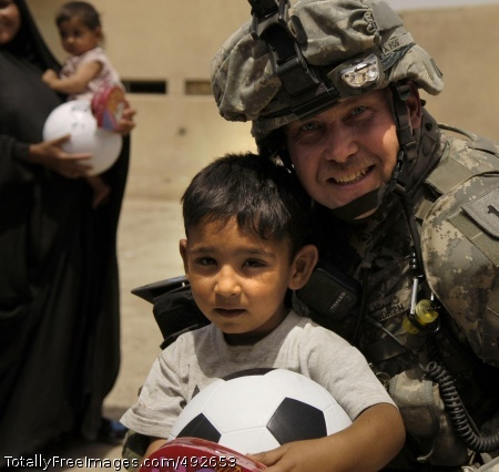 Soccer Ball Sgt. 1st Class Jeffrey Whitworth gives a child a soccer ball in Al Furat, Iraq. Sgt. 1st Class Whitworth is assigned to the National Police Transition Team. Photo Credit: Jul 5, 2007
