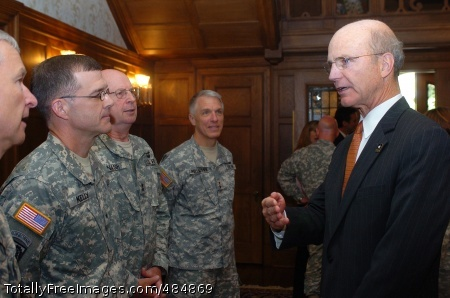 Minnesota Secretary of the Army Pete Geren talks with senior military leaders at Minnesota Governor Tim Pawlenty's home prior to the Minnesota Army Family Community Covenant signing ceremony at the Minnesota State Capitol building, June 16.  Photo Credit: Jun 16, 2008