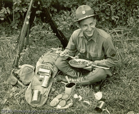 MMMM, Good! MSGT Victor Horwath, 174th Infantry, NYNG tests the Army's new Field Ration C during First Army's summer maneuvers, New York, 1940. (Source: QM Food Rations Photograph Collection).  Photo Credit: Oct 28, 2007