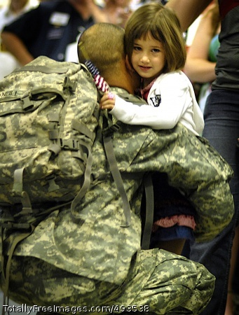 Good to be Home A Soldier hugs his daughter at the Dallas/Fort Worth International Airport April 3, after returning from Iraq. Photo Credit: May 11, 2007