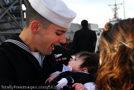 110216-N-OS574-168 NORFOLK (Feb. 16, 2011) Engineman 3rd Class Christopher Mann greets his daughter for the first time the guided-missile destroyer USS Laboon (DDG 58) arrives at Naval Station Norfolk. Laboon deployed for six months as part of a Standing Naval Maritime Group, a multi-national maritime force that trains and operates together and is available to NATO. (U.S. Navy photo by Mass Communication Specialist 2nd Class Josue L. Escobosa/Released)