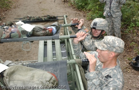 Northern Exposure Soldiers prepare to tie a litter to the back of a Humvee. Photo Credit: Aug 16, 2007