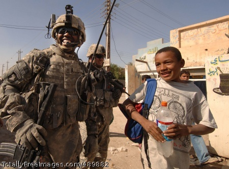 Market Patrol Sgt. 1st Class David Bess makes friends with Iraqi children. Photo Credit: Nov 13, 2007