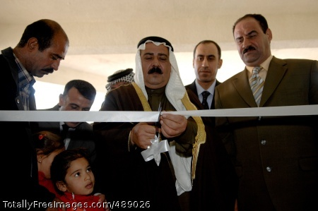 CAMP TAJI, Iraq -- Joined by Iraqi government officials from local, provincial and national government offices, tribal sheik Nadim Al Sultan (center) of Sab Al Bor cuts the ribbon during the opening of the Sab Al Bor Governance Center of Taji in Sab Al Bor, Iraq Dec. 13.  Photo Credit: Dec 18, 2007