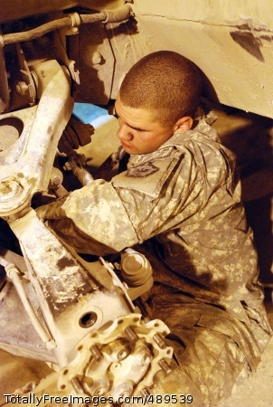Army Mechanics Go Army Pfc. Carson Beaver, a mechanic from Headquarters Support Company, 864th Engineer Battalion strains to reach into the engine of a Humvee that needs repair at Forward Operating Base Sharana, Afghanistan, Nov. 7.  Photo Credit: Nov 27, 2007