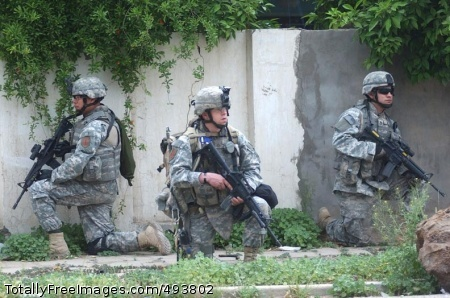 Combined Patrol in Soldiers halt but remain vigilant during the patrol. Photo Credit: Apr 26, 2007