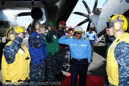 110408-N-IC111-016 PACIFIC OCEAN (April 8, 2011) Indian navy Rear Adm. Harish Bisht, flag officer of Commanding Eastern Fleet, returns honors as he walks through rainbow side boys aboard the aircraft carrier USS Ronald Reagan (CVN 76). Ronald Reagan is participating in Exercise Malabar, a bi-lateral coordination with the Indian navy and is operating in the western Pacific Ocean. (U.S. Navy photo by Mass Communication Specialist 3rd Class Kevin B. Gray/Released)