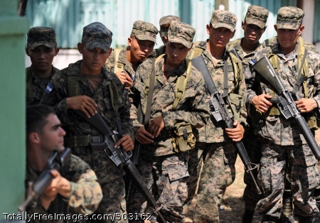 110315-N-EC642-594  SAN LORENZO, Honduras (March 15, 2011) U.S. Marine Staff Sgt. Daniel Monteiro, lower left, assigned to Marine Corps Training and Advisory Group, demonstrates proper tactical movement to soldiers assigned to 11th Honduran Army Battalion during a weeklong subject matter expert exchange in support of Southern Partnership Station (SPS) 2011. SPS is an annual deployment of U.S. ships to the U.S. Southern Command area of responsibility in the Caribbean and Latin America. (U.S. Navy photo by Mass Communication Specialist 2nd Class Ricardo J. Reyes/Released)