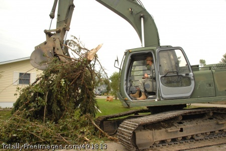 Twister! Sgt. Jay E. Haaland clears large trees and branches using a hydraulic excavator. Photo Credit: Aug 30, 2007