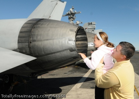 110212-N-7516W-125 MAYPORT, Fla. (Feb. 12, 2011) Cmdr. Steven Mauro, assigned to Naval Facilities Engineering Command Southeast, lifts his daughter for a view inside the afterburners of an F/A-18A Hornet aboard the aircraft carrier USS George H.W. Bush (CVN 77). George H.W. Bush is on a scheduled port visit to Naval Station Mayport. (U.S. Navy photo by Mass Communication Specialist 3rd Class Timothy Walter/Released)