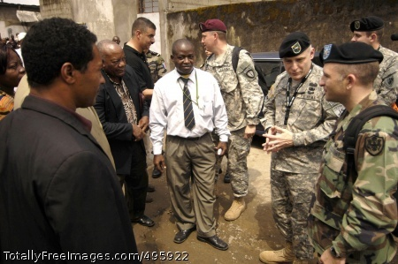 On duty in Africa U.S. and French Army Soldiers discuss progress on a nearby Red Cross clinic with local citizens in Douala, Cameroon. The clinic is being restored as part of the Combined/Joint Exercise Recamp V.  Photo Credit: Dec 4, 2006